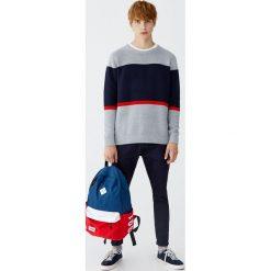 Spodnie typu chinos carrot fit. Czarne chinosy męskie marki Pull&Bear, m. Za 89,90 zł.