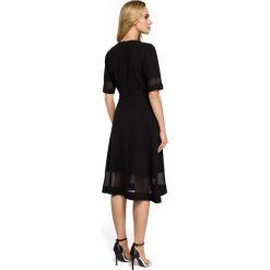 ALEXIS Sukienka z szyfonem - czarna. Niebieskie sukienki koktajlowe marki numoco, na imprezę, s, w kwiaty, z jeansu, sportowe. Za 154,90 zł.