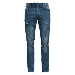 Q/S Designed By Jeansy Męskie 31/32 Niebieski. Niebieskie jeansy męskie z dziurami marki Oakley, na lato, z bawełny, eleganckie. W wyprzedaży za 239,00 zł.