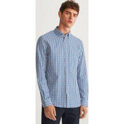 Koszula w kratkę regular fit - Niebieski. Niebieskie koszule męskie na spinki Reserved, l, w kratkę. Za 99,99 zł.