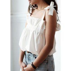 Bluzka Mela White M/L. Białe bluzki asymetryczne Laurella, l, z wiskozy. Za 99,00 zł.
