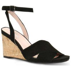 Sandały HANA. Czarne sandały damskie Gino Rossi, w paski, ze skóry, na koturnie. Za 259,90 zł.