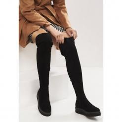 Czarne Kozaki Marengo. Czarne buty zimowe damskie Born2be, z materiału, z okrągłym noskiem, na platformie. Za 129,99 zł.