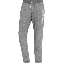 Abercrombie & Fitch CORE LOGO CLASSIC PANT Spodnie treningowe dark grey texture. Niebieskie spodnie dresowe męskie marki Abercrombie & Fitch. Za 349,00 zł.