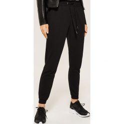 Dresowe joggery - Czarny. Czarne spodnie dresowe męskie House, m, z dresówki. Za 59,99 zł.