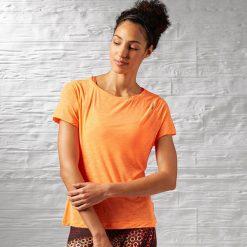 Reebok Koszulka damska Work Out Ready Slub textured Tee  pomarańczowy r. M (AJ3422). Szare topy sportowe damskie marki Reebok, l, z dzianiny, casualowe, z okrągłym kołnierzem. Za 79,45 zł.