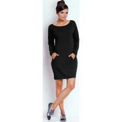 Czarna Prosta Dresowa Sukienka z Kieszenią Kangurką. Czarne sukienki dresowe marki Molly.pl, na co dzień, uniwersalny, sportowe, z kapturem, proste. W wyprzedaży za 108,72 zł.