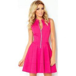 123-8 sukienka z ekspresem z przodu i kieszonkami - malina. Różowe sukienki marki numoco, l, z dekoltem w łódkę, oversize. Za 139,00 zł.