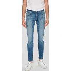 Wrangler - Jeansy Larston. Niebieskie rurki męskie marki House, z jeansu. W wyprzedaży za 229,90 zł.