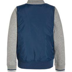 Converse Kurtka przejściowa navy. Niebieskie kurtki chłopięce przejściowe marki Converse, z materiału. Za 319,00 zł.