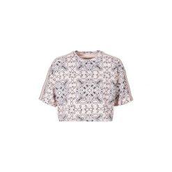 T-shirty z krótkim rękawem Converse  CROPPED TEE MILEY CYRUS. Czerwone t-shirty damskie marki Converse, m. Za 139,30 zł.