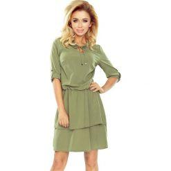Diana Sukienka z podwójną spódnicą i rękawkiem. Zielone sukienki na komunię numoco, s, z podwójnym kołnierzykiem, oversize. Za 155,99 zł.