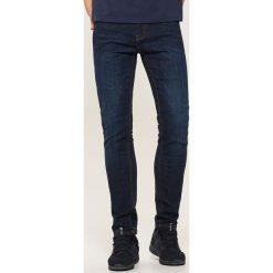 Jeansy skinny - Niebieski. Czarne jeansy męskie skinny marki KIPSTA, z poliesteru, do piłki nożnej. Za 99,99 zł.