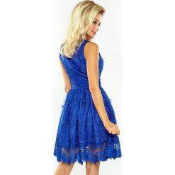 DORLIN Ekskluzywna rozkloszowana sukienka - CHABROWA. Niebieskie sukienki na komunię marki numoco, na imprezę, s, w kwiaty, z jeansu, sportowe, sportowe. Za 349,98 zł.
