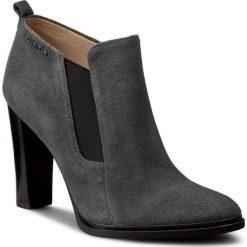 Botki CALVIN KLEIN BLACK LABEL - Jalene N11528 Ebony. Czarne buty zimowe damskie marki Calvin Klein Black Label, z materiału. W wyprzedaży za 409,00 zł.