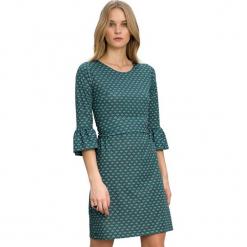 Sukienka w kolorze ciemnozielonym. Zielone sukienki na komunię marki Almatrichi, l, z okrągłym kołnierzem, midi, proste. W wyprzedaży za 169,95 zł.
