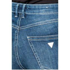 Guess Jeans - Jeansy 1981. Niebieskie jeansy damskie marki Guess Jeans, z aplikacjami, z bawełny, z podwyższonym stanem. W wyprzedaży za 269,90 zł.