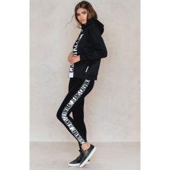 Odzież damska: Calvin Klein Legginsy Logo WW - Black