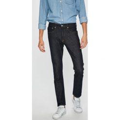 Calvin Klein Jeans - Jeansy. Niebieskie jeansy męskie z dziurami marki Calvin Klein Jeans. Za 399,90 zł.