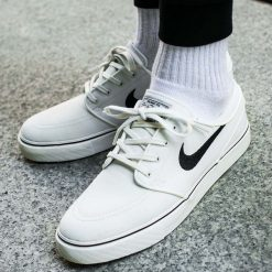 """Buty Nike Zoom Stefan Janoski Canvas """"White"""" (615957-100). Białe buty skate męskie Nike, na wiosnę, z materiału, nike zoom. Za 249,99 zł."""