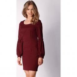 Sukienka w kolorze bordowym. Czerwone długie sukienki marki Last Past Now, xs, z dekoltem na plecach, z długim rękawem. W wyprzedaży za 149,95 zł.
