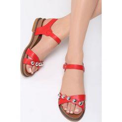 Czerwone Sandały Ramble On. Czerwone sandały damskie marki Born2be, z materiału, na obcasie. Za 79,99 zł.