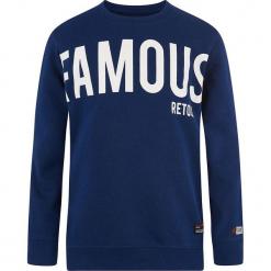 Bluza w kolorze niebieskim. Niebieskie bluzy chłopięce marki Retour Denim de Luxe, z nadrukiem. W wyprzedaży za 82,95 zł.