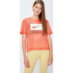 Nike Sportswear - Top 917565. Różowe topy damskie Nike Sportswear, l, z nadrukiem, z poliesteru, z okrągłym kołnierzem. W wyprzedaży za 99,90 zł.
