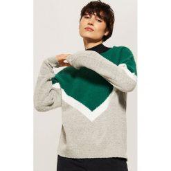 Trójkolorowy sweter - Wielobarwn. Czarne swetry klasyczne damskie marki KIPSTA, z poliesteru, do piłki nożnej. Za 69,99 zł.