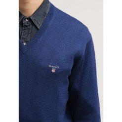GANT Sweter marine melange. Niebieskie kardigany męskie marki GANT. Za 419,00 zł.