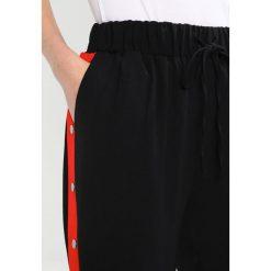 Spodnie dresowe damskie: New Look Spodnie treningowe black