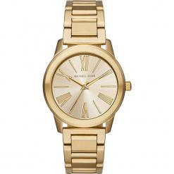 """Zegarek kwarcowy """"Hartman"""" w kolorze złotym. Żółte, analogowe zegarki damskie marki Michael Kors, ze stali. W wyprzedaży za 560,95 zł."""