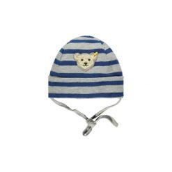 Steiff  Boys Czapka stripe blue - niebieski - Gr.Moda (6 - 24 miesięcy ). Niebieskie czapeczki niemowlęce marki Steiff, z aplikacjami, z bawełny. Za 95,00 zł.