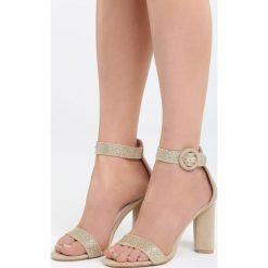 Beżowe Sandały Nice Meeting. Brązowe sandały damskie na słupku marki Born2be, z materiału, na wysokim obcasie. Za 89,99 zł.
