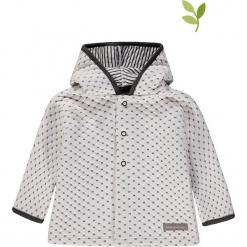 Bluza w kolorze biało-czarnym. Białe bluzy dziewczęce rozpinane marki bellybutton, z bawełny. W wyprzedaży za 72,95 zł.