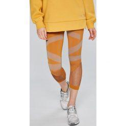 Adidas by Stella McCartney - Legginsy. Szare legginsy adidas by Stella McCartney, l, z dzianiny. W wyprzedaży za 279,90 zł.