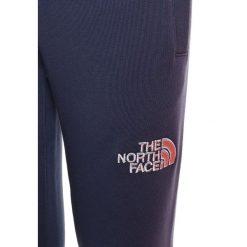 The North Face Spodnie treningowe cosmic blue. Niebieskie spodnie chłopięce marki The North Face. Za 199,00 zł.