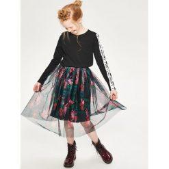 Tiulowa spódnica midi - Czarny. Czarne spódniczki dziewczęce marki Reserved, z tiulu, midi. W wyprzedaży za 29,99 zł.