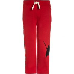 GAP BOYS ACTIVE ARCH  Spodnie treningowe modern red. Czerwone spodnie dresowe dziewczęce GAP, z bawełny. Za 129,00 zł.