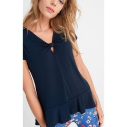 Odzież damska: Koszulka z falbanką