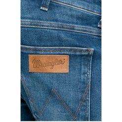 Wrangler - Jeansy. Niebieskie jeansy męskie z dziurami Wrangler. W wyprzedaży za 279,90 zł.