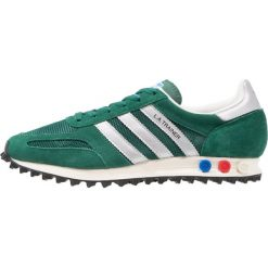 Adidas Originals LA TRAINER OG Tenisówki i Trampki collegiate green/matte silver/core black. Szare tenisówki damskie marki adidas Originals, z gumy. Za 409,00 zł.