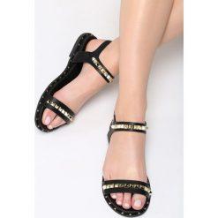 Czarne Sandały Lunar. Czarne sandały damskie marki Born2be, z materiału, na obcasie. Za 69,99 zł.
