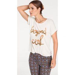 Odzież damska: Koszulka w kolorze biało-złotym
