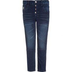 Name it NITTOSS Jeansy Slim Fit medium blue denim. Niebieskie jeansy męskie relaxed fit Name it, z bawełny. W wyprzedaży za 135,20 zł.