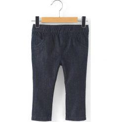 Proste dżinsy 1 miesiąc - 3 latka. Niebieskie jeansy dziewczęce La Redoute Collections, z bawełny, z standardowym stanem. Za 52,88 zł.