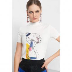 Koszulka z nadrukiem. Brązowe bluzki z golfem marki Orsay, s, w kolorowe wzory, z dzianiny, z krótkim rękawem. Za 39,99 zł.