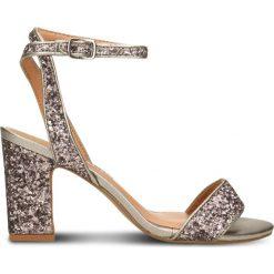 Sandały TAHIRA. Czerwone sandały damskie na słupku marki Gino Rossi, w paski, z tworzywa sztucznego, na wysokim obcasie. Za 279,90 zł.
