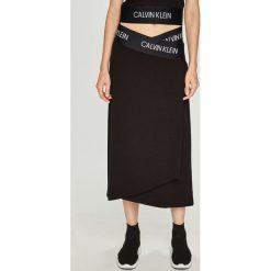Calvin Klein Performance - Spódnica. Szare spódniczki dzianinowe marki Calvin Klein Performance, m, midi, rozkloszowane. Za 299,90 zł.