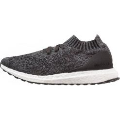 Adidas Performance ULTRABOOST UNCAGED Obuwie do biegania treningowe core black/solid grey/grey three. Czarne buty sportowe chłopięce adidas Performance, z materiału. W wyprzedaży za 339,50 zł.